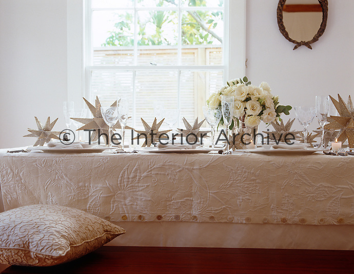 A length of taffeta with a textured overcloth create a traditional yet modern Christmas table