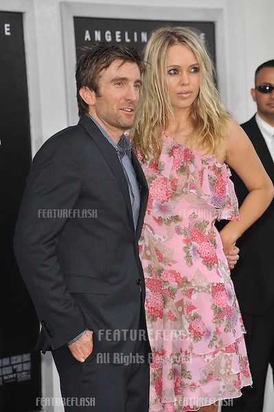 "Sharlto Copley & date at the premiere of ""Salt"" at Grauman's Chinese Theatre, Hollywood..July 19, 2010  Los Angeles, CA.Picture: Paul Smith / Featureflash"