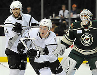 San Antonio Rampage right wing Logan Shaw, center, and center Vincent Trocheck, left, chase the puck in front of Iowa Wild goaltender John Curry during the second period of an AHL hockey game, Saturday, Jan. 25, 2014, in San Antonio (Darren Abate/AHL)