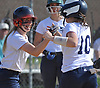 Sarah Chapman #2 of Smithown West, left, congratulates Jill Meaney #10 after a sacrifice fly that allowed Chapman to score in the bottom of the third inning of a Suffolk League IV varsity softball game against rival Smithtown East at Smithtown High School West on Wednesday, May 2, 2018. Meaney drove in three runs in West's 7-1 win.