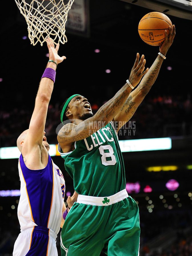 Jan. 28, 2011; Phoenix, AZ, USA; Boston Celtics guard Marquis Daniels (8) puts up a shot against the Phoenix Suns forward Marcin Gortat  (4) at the US Airways Center. Mandatory Credit: Mark J. Rebilas-