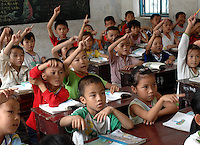 Children in class at the Danzhou Shi Yan Primary school, Danzhou City, Hainan Island, China. Danzhou city has the highest gender imbalance in China with 170 males born for every 100 females according to figures from Chinese Government 5t National Census. The imbalance is already having a massive social impact on society and is expected to get worse while the ruthless One Child Policy, aimed at curbing China's 1.3 billion population, continues to be law..PHOTO BY SINOPIX
