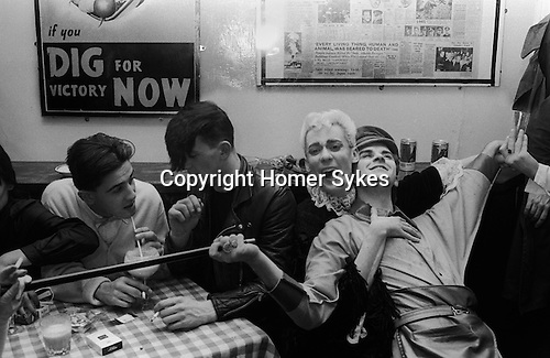 Steve Strange lying back with Stephen Linard  at the Blitz Club Covent Garden London 1980.<br />
