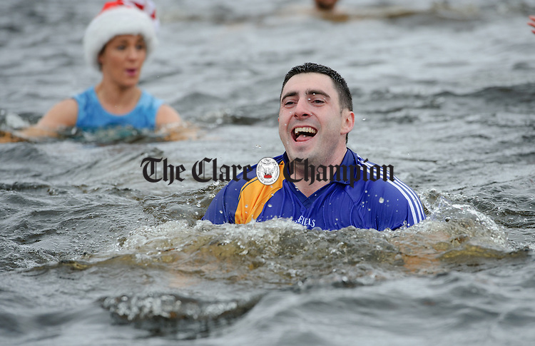 Gearoid O Connell making waves during the annual Christmas day swim at Gortglas  Lake, Kildysart in aid of the West Clare Mini Marathon Cancer fund. Photograph by John Kelly.