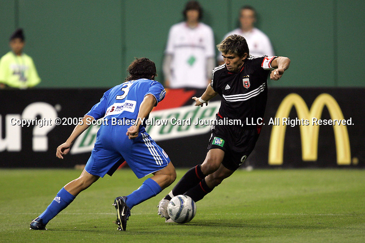 21 May 2005: DC United's Jaime Moreno (right) tries to dribble past Kansas City defender Nick Garcia. DC United defeated the Kansas City Wizards 3-2 at RFK Stadium in Washington, DC in a regular season Major League Soccer game. .