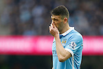 Martin Demichelis of Manchester City dejected during the Barclays Premier League match at the Etihad Stadium. Photo credit should read: Philip Oldham/Sportimage