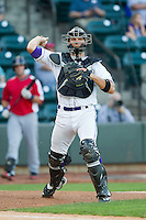 Winston-Salem Dash catcher Kevan Smith (24) makes a throw to first base against the Salem Red Sox at BB&T Ballpark on August 15, 2013 in Winston-Salem, North Carolina.  The Red Sox defeated the Dash 2-1.  (Brian Westerholt/Four Seam Images)