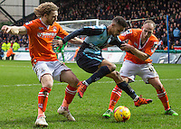 Paris Cowan-Hall of Wycombe Wanderers holds off Craig Mackail-Smith of Luton Town & Jake Howells (right) of Luton Town during the Sky Bet League 2 match between Wycombe Wanderers and Luton Town at Adams Park, High Wycombe, England on 6 February 2016. Photo by Massimo Martino.