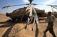 This Apache Longbow Delta model may be a total loss after the pilot lost control on take off and tipped on its side destroying the rotor blades and collapsing the landing gear. The Apaches were on their way to a forward areqa in Iraq when they cam under heavy small arms fire and were forced to land in an unfamiliar landing area. One pilot was wounded in the neck and few Apaches were hit with enemy artillary. This compromised the objective and with sandstorms moving through the region flight operations grinded to a halt. This will be the first time the Longbow model will be used in war.