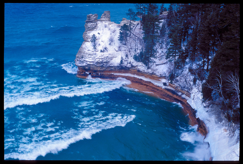 MINER'S CASTLE ROCK FORMATION IN THE PICTURED ROCKS NATIONAL LAKESHORE NEAR MUNISING MICHIGAN DURING A WINTER STORM.