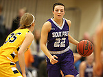 SIOUX FALLS, SD - DECEMBER 31: Mariah Szymanski #22 from the University of Sioux Falls brings the ball up court against Presley O'Farrell #35 from Augustana University during their game Sunday afternoon December 31, 2017 at the Stewart Center in Sioux Falls. (Photo by Dave Eggen/Inertia)