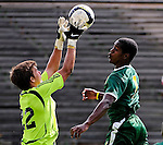 13 September 2009: University of Massachusetts Minutemen goalkeeper Shane Curran-Hays, a Sophomore from Camp Hill, PA, makes a save on a fast approaching University of Vermont Catamount forward/midfielder T.J. Gore, a Senior from Macomb, MI, during the second round of the 2009 Morgan Stanley Smith Barney Soccer Classic held at Centennial Field in Burlington, Vermont. The Catamounts and Minutemen battled to a 1-1 double-overtime tie. Mandatory Photo Credit: Ed Wolfstein Photo