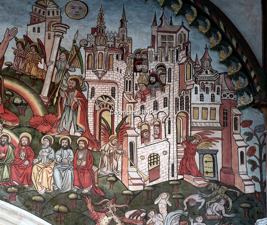 BNPS.co.uk (01202 558833)<br /> Pic: PhilYeomans/BNPS.<br /> <br /> Doom finally has its day! - A 500 year old 'Day of Judgement' painting, that has survived Henry VIII th, the Puritans and even Victorian prudery has been restored to its former glory.<br /> <br /> Thought to be the largest medieval 'Doom' painting in the country, the striking image been painstakingly restored after a tumultuous 500 year history on the chancel arch of St Thomas Becket church in Salisbury.<br /> <br /> Originally painted in the 15th century, the chancel was white-washed during the Reformation before being uncovered nearly 300 years later in the early 19th century. <br /> <br /> Prudish Victorian's shocked by the naked images then recovered it before it finally re-emerged in 1881 as opinions relaxed. <br /> <br /> Experts have spent three months conserving the faded painting, which included injecting lime slurry behind areas of paint to affix them again to the wall. and delicately 'touching up' in places before finishing it with varnish to bring out its colour.<br /> <br /> Most pre 16th century churches and cathedrals in Britain would have been plastered with religious images and iconography to encourage their often illiterate congregation to good behaviour.<br /> <br /> But during Henry VIII th Protestant Reformation churches were stripped of all graven imagery and the paintings were either whitewashed over or completely destroyed.<br /> <br /> Because of this very few works still survive today making the Salisbury fresco a truly remarkable survivor.<br /> <br /> The restoration is part of a larger set of works at the historic church which are due to cost £1.5million.
