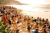 USA, Hawaii, large crowd of people watch the Eddie Aikau surfing competition at Waimea Bay