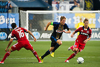 Brian Carroll (7) of the Philadelphia Union looks to split Marco Pappa (16) and Chris Rolfe (18) of the Chicago Fire. The Chicago Fire defeated the Philadelphia Union 3-1 during a Major League Soccer (MLS) match at PPL Park in Chester, PA, on August 12, 2012.