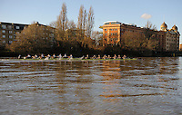 19.01.2014. River Thames, London, England. Oxford University Boat Club Trial VIIIs, both crews pass the Harrods Repository. The Trial serves as part of the selection process to determine who will represent Oxford University in the 160th running of the University Boat Race on April 6th 2014. The trial for the two eights, named Persistent and Stubborn is the only occasion during the season that the squad members can race side-by-side over the full four and a quarter miles of the Championship Course between Putney and Mortlake in a simulation of The BNY Mellon Boat Race.