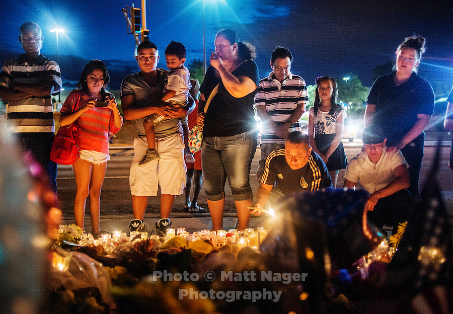 A vigil is held next to the Aurora Century 16 movie theater in Aurora, Colorado, Friday, July 20, 2012. James Holmes (cq), 24, is suspected in the shooting that killed 12 people and wounded many more...Photo by MATT NAGER