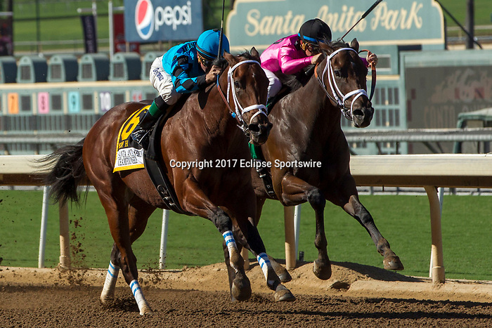 """ARCADIA, CA. OCTOBER 7: #6 Roy H, ridden by Kent Desormeaux, overtakes #5 Mr. Hinx, ridden by Drayden Van Dyke, in the stretch of the Santa Anita Sprint Championship (Grade l)""""Win and You're In Sprint Division"""" on October 7, 2017, at Santa Anita Park in Arcadia, CA. (Photo by Casey Phillips/Eclipse Sportswire/Getty Images)"""