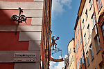 An antique store sign on the corner of a pink building in the old town of Stockholm, Sweden