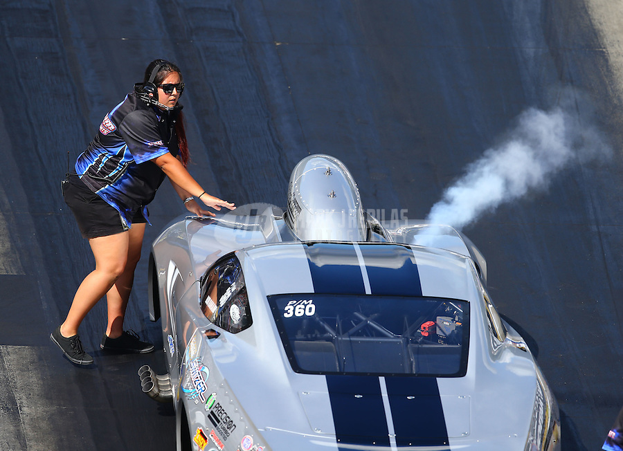 Jun 17, 2016; Bristol, TN, USA; Crew member for NHRA pro mod driver Bob Rahaim during qualifying for the Thunder Valley Nationals at Bristol Dragway. Mandatory Credit: Mark J. Rebilas-USA TODAY Sports