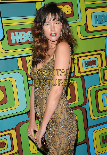 PAZ DE LA HUERTA.The HBO's Post Golden Globes Party held at The Beverly Hilton Hotel in Beverly Hills, California, USA..January 16th, 2011.half length dress gold brown print lace side clutch bag red lipstick shiny greasy face skin.CAP/RKE/DVS.©DVS/RockinExposures/Capital Pictures.
