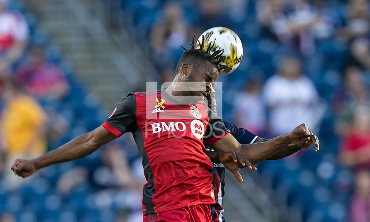 Foxborough, Massachusetts - September 23, 2017: First half action. In a Major League Soccer (MLS) match, New England Revolution (blue/white) vs Toronto FC (red), at Gillette Stadium.