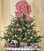 """The 2016 White House Christmas decorations are previewed for the press at the White House in Washington, DC on Tuesday, November 29, 2016.  pictured are a few of the fifty-six LEGO gingerbread houses—one for each state and territory—made from more than 200,000 LEGOS that nestle in the branches of the trees throughout the State Dining Room. The first lady's office released the following statement to describe those decorations, """"This year's holiday theme, 'The Gift of the Holidays,' reflects on not only the joy of giving and receiving, but also the true gifts of life, such as service, friends and family, education, and good health, as we celebrate the holiday season.""""<br /> Credit: Ron Sachs / CNP"""