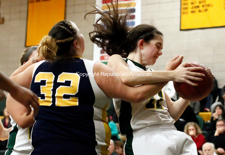 Waterbury, CT- 16 December 2014-121614CM12-  Kennedy's Sydney DelGado, (32), attempts to strip the ball from Holy Cross' Kaitlyn Grimshaw during their NVL matchup in Waterbury on Tuesday.   Christopher Massa Republican-American