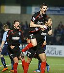 Bilel Mohsni celebrates his goal at Station Park with Jon Daly and Seb Faure