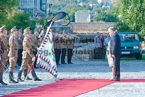 Atifete Jahjaga (L) president of the Republic of Kosovo and her Hungarian counterpart Pal Schmitt (R) inspect the guard of honor during a welcoming ceremony in Budapest, Hungary on September 14, 2011. ATTILA VOLGYI