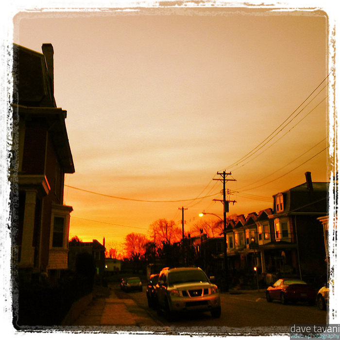 The eastern sky blazes with an orange glow just before sunrise, as seen from Cherokee Street in the Germantown section of Philadelphia, December 20, 2012.