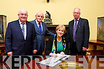 Minister Heather Humphries  at the Muckross House 50th anniversary celebrations on Sunday evening signs the guest book with Senator Paul Coughlan, Michael Larkin Chairman of the board and John Fitzgerald