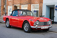 Beautiful classic Triumph TR4 sportscar parked on a street in Copenhagen, Denmark.