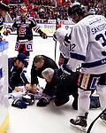 Södertälje 2013-02-02 Ishockey Allsvenskan , Södertälje SK - BIK Karlskoga :  .BIK Karlskoga 19 Björn Kindahl ses till av sjukvårdspersonal efter tuff tackling mot sargen.(Byline: Foto: Kenta Jönsson) Nyckelord: