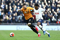 1st March 2020; Tottenham Hotspur Stadium, London, England; English Premier League Football, Tottenham Hotspur versus Wolverhampton Wanderers; Matt Doherty of Wolverhampton Wanderers competes for the ball with Steven Bergwijn of Tottenham Hotspur