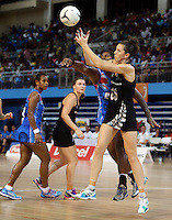 22.01.2015 Silver Ferns Bailey Mes and Fiji's Mere Neiliko in action during the netball test match between the Silver Ferns and Fiji at the Vodafone Arena in Suva Fiji. Mandatory Photo Credit ©Michael Bradley.