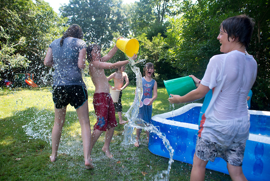 Cousins and friends playing with water. Roofball Tournament. The Barn. Bridgehampton, New York 2012