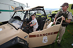 BLM Ranger Scott Fischer lets Darren Plain, 3, check a vehicle at the 11th annual National Night Out hosted by the Carson City Sheriff's Office in Carson City, Nev., on Tuesday, Aug. 6, 2013. <br />