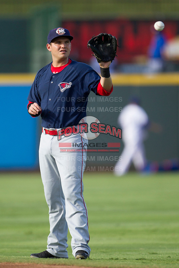 Oklahoma City RedHawks third baseman Brandon Laird (4) warms up before the Pacific Coast League baseball game against the Round Rock Express during on August 25, 2013 at the Dell Diamond in Round Rock, Texas. Round Rock defeated Oklahoma City 9-2. (Andrew Woolley/Four Seam Images)