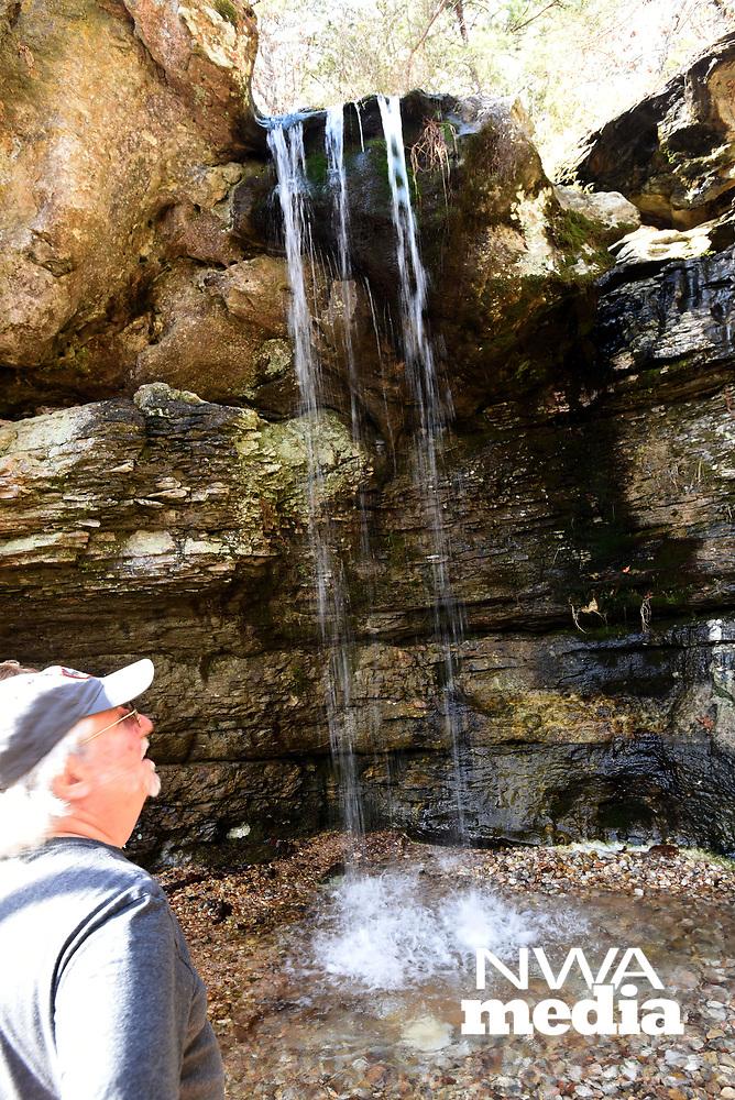 """NWA Democrat-Gazette/FLIP PUTTHOFF <br /> Dennis """"Hete"""" Heter admires the waterfall Jan. 18 2019 at Madison County Wildlife Management Area."""