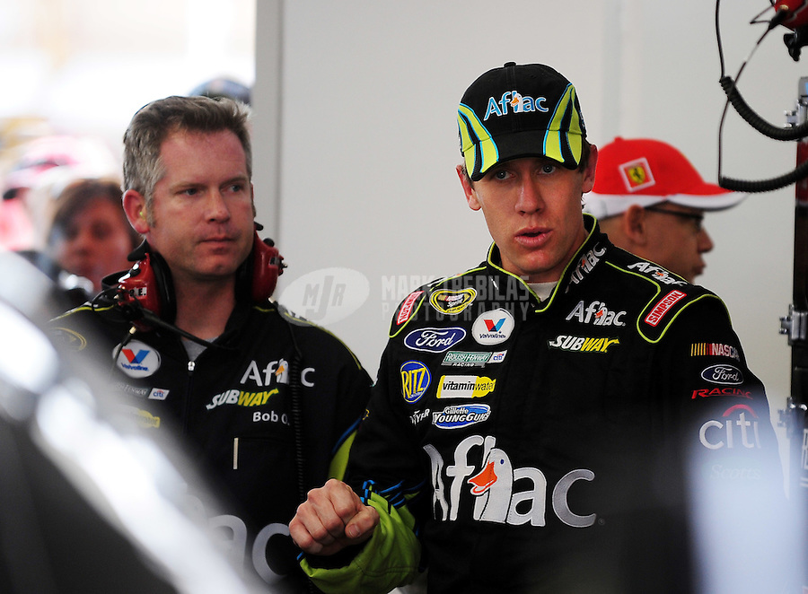 Feb. 27, 2009; Las Vegas, NV, USA; NASCAR Sprint Cup Series driver Carl Edwards (right) with crew chief Bob Osborne during practice for the Shelby 427 at Las Vegas Motor Speedway. Mandatory Credit: Mark J. Rebilas-