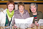 CHECKING: Joan O'Connor (Scartaglin), Eileen Murphy and margaret Slattery (Doon,Tralee).checking their programme as they were at the Kingdom Greyhound Stadium, on Friday night.