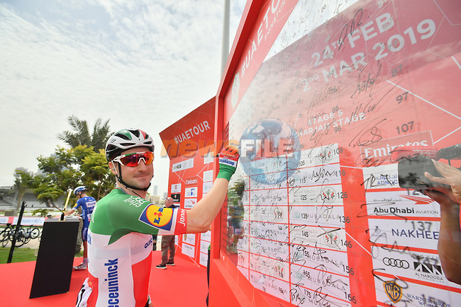 Italian National Champion Elia Viviani (ITA) Deceuninck-Quick Step sign on before the start of Stage 5 of the 2019 UAE Tour, running 181km form Sharjah to Khor Fakkan, Dubai, United Arab Emirates. 28th February 2019.<br /> Picture: LaPresse/Massimo Paolone | Cyclefile<br /> <br /> <br /> All photos usage must carry mandatory copyright credit (© Cyclefile | LaPresse/Massimo Paolone)
