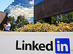FILE-In this Monday, May 9, 2011, photo, LinkedIn Corp., the professional networking Web site, displays its logo outside of headquarters in Mountain View, Calif. Silicon Valley, it turns out, doesn't revolve around the stock prices of Facebook and its playful sidekick, Zynga. Instead, the optimism in Silicon Valley can be seen in a variety of ways in this area that covers roughly 40 miles from San Jose to San Francisco.  (AP Photo/Paul Sakuma)