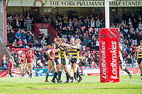 Picture by Allan McKenzie/SWpix.com - 22/04/2018 - Rugby League - Ladbrokes Challenge Cup - York City Knight v Catalans Dragons - Bootham Crescent, York, England - York's Joe Porter is congratulated on his second try against Catalans.