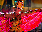 14 JULY 2016 - UBUD, BALI, INDONESIA: A traditional Balinese legong dance troupe performs during the mass cremation in Ubud. Local people in Ubud exhumed the remains of family members and burned their remains in a mass cremation ceremony Wednesday. Thursday was spent preparing for Saturday's ceremony that concludes the cremation and included traditional Balinese Legong dances performed in the evening. Almost 100 people will be cremated and laid to rest in the largest mass cremation in Bali in years this week. Most of the people on Bali are Hindus. Traditional cremations in Bali are very expensive, so communities usually hold one mass cremation approximately every five years. The cremation in Ubud will conclude Saturday, with a large community ceremony.   PHOTO BY JACK KURTZ