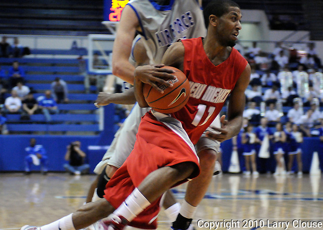 January 20, 2010: New Mexico guard, Nate Garth (11), drives the baseline during the Lobos  Mountain West Conference match-up with Air Force at Clune Arena, U.S. Air Force Academy, Colorado Springs, Colorado.  New Mexico defeats Air Force 73-50.