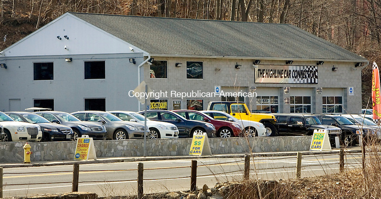 WATERBURY, CT. 07 February 2012-020712SV05-A long line of cars sits out front of The Highline Car Connection on Watertown Avenue in Waterbury Tuesday. The used car dealership has expanded by knocking down an adjacent restaurant and extending its showroom..Steven Valenti Republican-American
