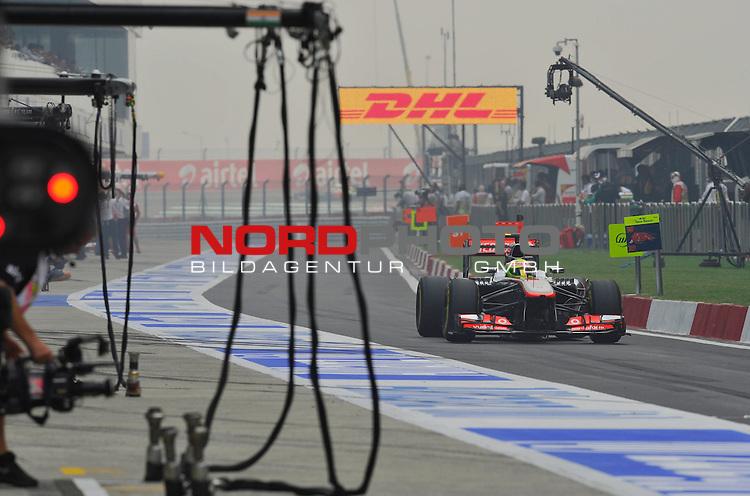 25.-27-10-2013, Jaypee-Circuit, Noida, IND, F1, Grosser Preis von Indien, Noida, im Bild  DHL Branding - Sergio Perez (MEX)  McLaren F1 Team  <br />  Foto &copy; nph / Mathis
