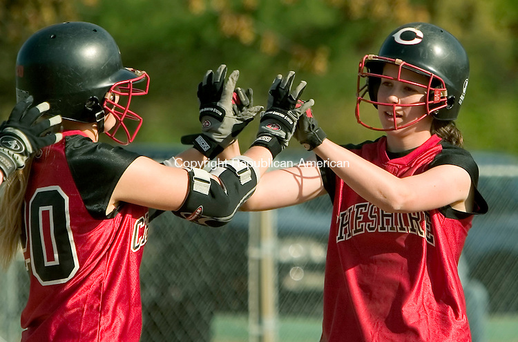 CHESHIRE, CT- 04 MAY 2008 --050508JS07-Cheshire's Gina Gongaware (24) right receives congratulations from teammate Christina Orcutt (20) after hitting the game winning run in the bottom of the seventh inning of their 2-1 win over Hamden Monday at Cheshire High School.<br /> Jim Shannon / Republican-American